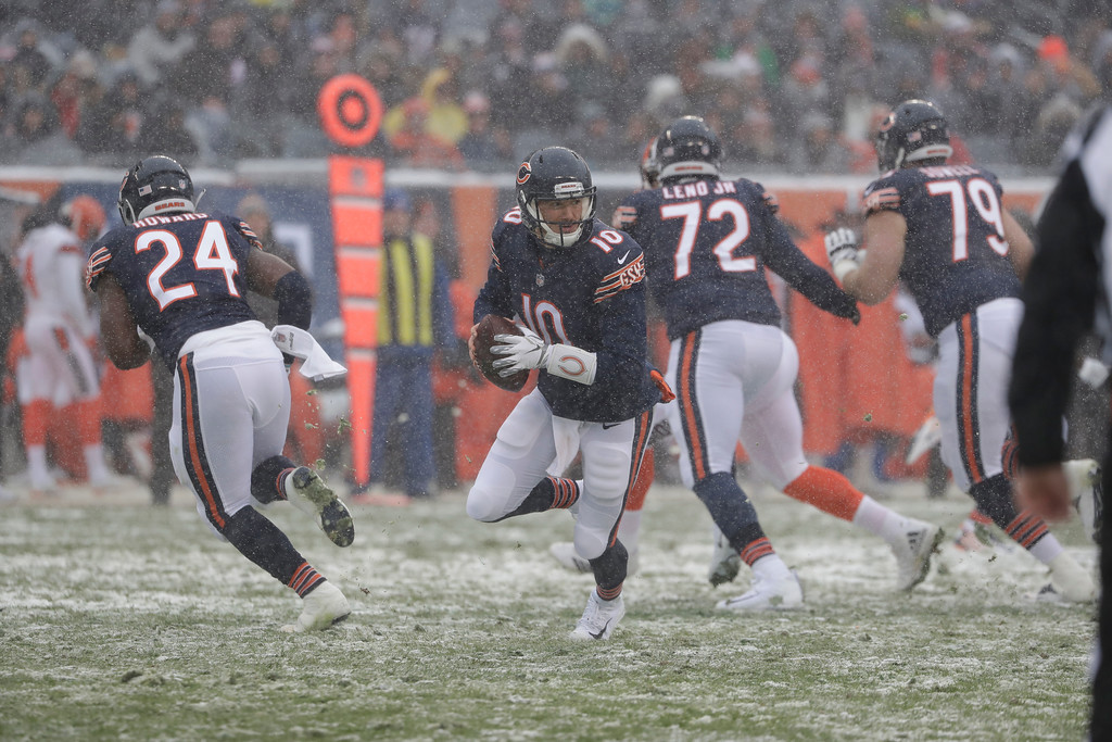 . Chicago Bears quarterback Mitchell Trubisky (10) rolls out against the Cleveland Browns in the first half of an NFL football game in Chicago, Sunday, Dec. 24, 2017. (AP Photo/Nam Y. Huh)
