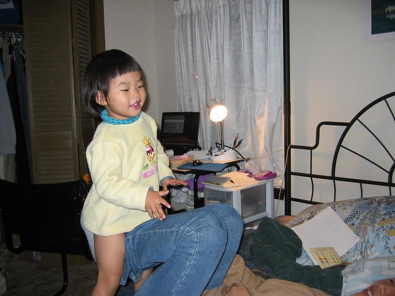 2003-Esther fly on mom leg.jpeg