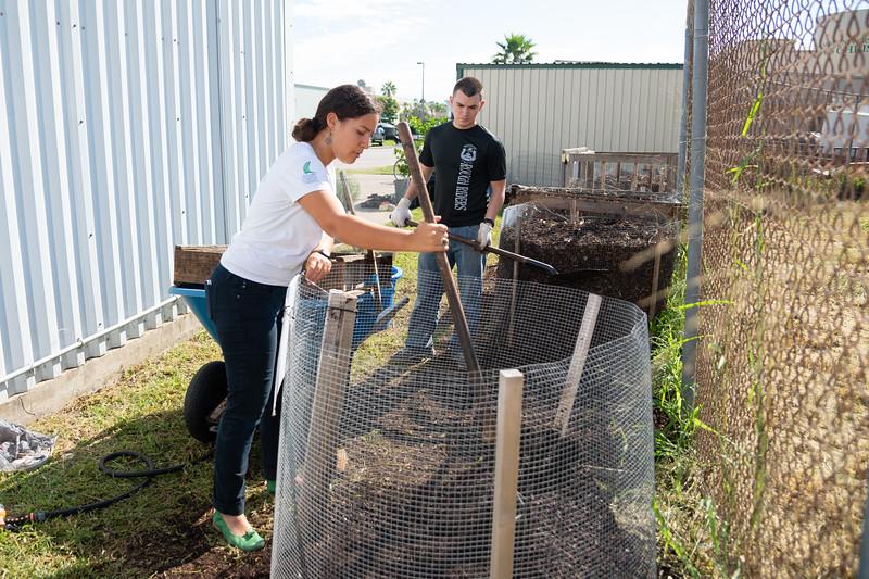 Students Melissa Zamora (left), and Mark Rolph volunteer at the Islander Green Garden.