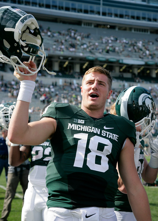 . Michigan State quarterback Connor Cook celebrates following a 56-14 win over Wyoming in an NCAA college football game, Saturday, Sept. 27, 2014, in East Lansing, Mich. (AP Photo/Al Goldis)