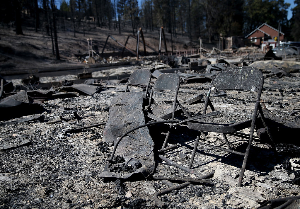. A row of folding chairs sit in the remains of destroyed business on September 16, 2014 in Weed, California. A fast moving wildfire fueled by high winds ripped through the town of Weed on the afternoon of September 15, burning 100 structures including the high school and lumber mill.  (Photo by Justin Sullivan/Getty Images)