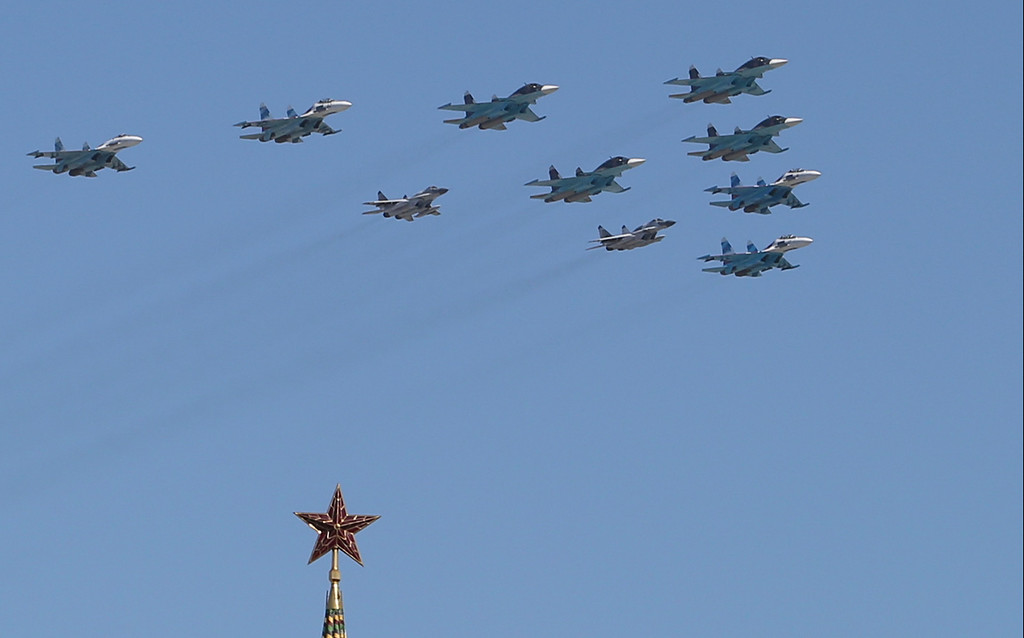 . Russian air force fighter jets fly during the Victory Day parade, which commemorates the 1945 defeat of Nazi Germany, in Red Square in Moscow, Russia, Friday, May 9, 2014.  (AP Photo/Denis Tyrin)