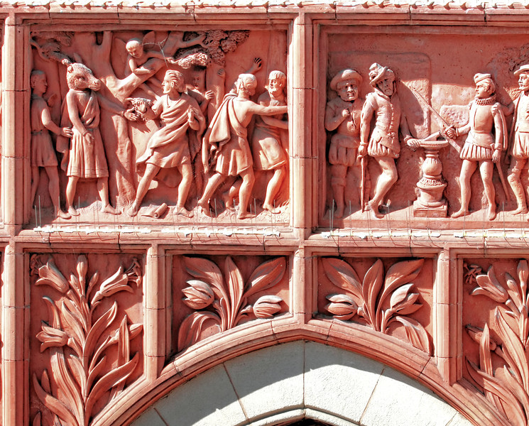 Terra Cotta scenes from Shakespeare's plays - above a doorway in Stratford-Upon-Avon