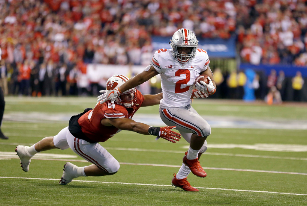 . Ohio State\'s J.K. Dobbins (2) is tackled by Wisconsin\'s T.J. Edwards during the second half of the Big Ten championship NCAA college football game, Saturday, Dec. 2, 2017, in Indianapolis. (AP Photo/Michael Conroy)