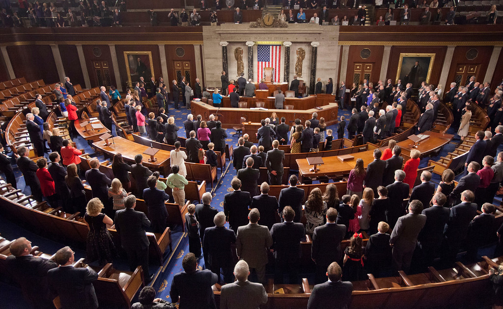 . Members of the House of Representatives stand for the Pledge of Allegiance at the opening session of the 114th Congress, on Capitol Hill in Washington, Tuesday, Jan. 6, 2015, as Republicans assume full control for the first time in eight years. House Speaker John Boehner of Ohio is expected to win a third despite a tea party-backed effort to unseat him, and Sen. Mitch McConnell, R-Ky., ascends to majority leader of the Senate after Democrats lost control in the wake of November\'s midterm elections. (AP Photo/Pablo Martinez Monsivais)