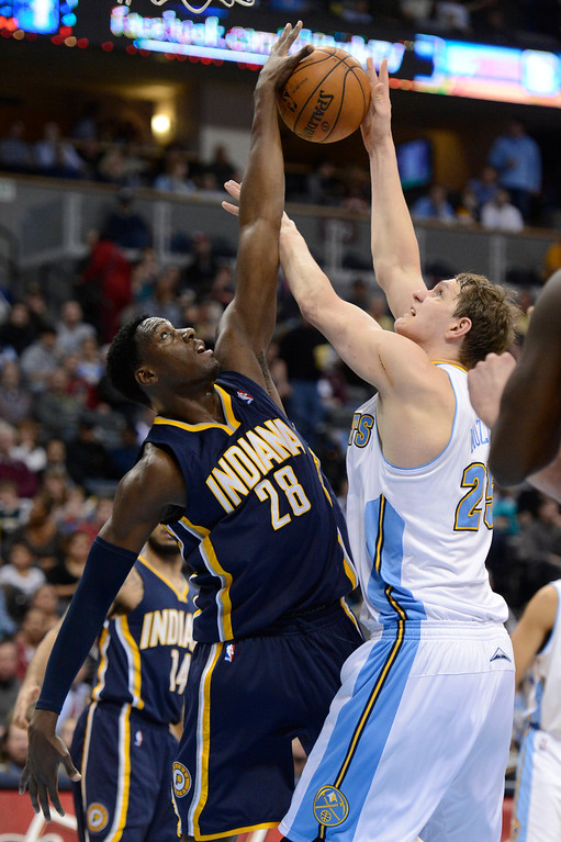 . DENVER, CO. - JANUARY 28: Denver Nuggets center Timofey Mozgov (25) gets fouled by Indiana Pacers center Ian Mahinmi (28) as he goes up for a shot  during the fourth quarter January 28, 2013 at Pepsi Center. The Denver Nuggets defeated  the Indiana Pacers 102-101 in NBA Action. (Photo By John Leyba / The Denver Post)