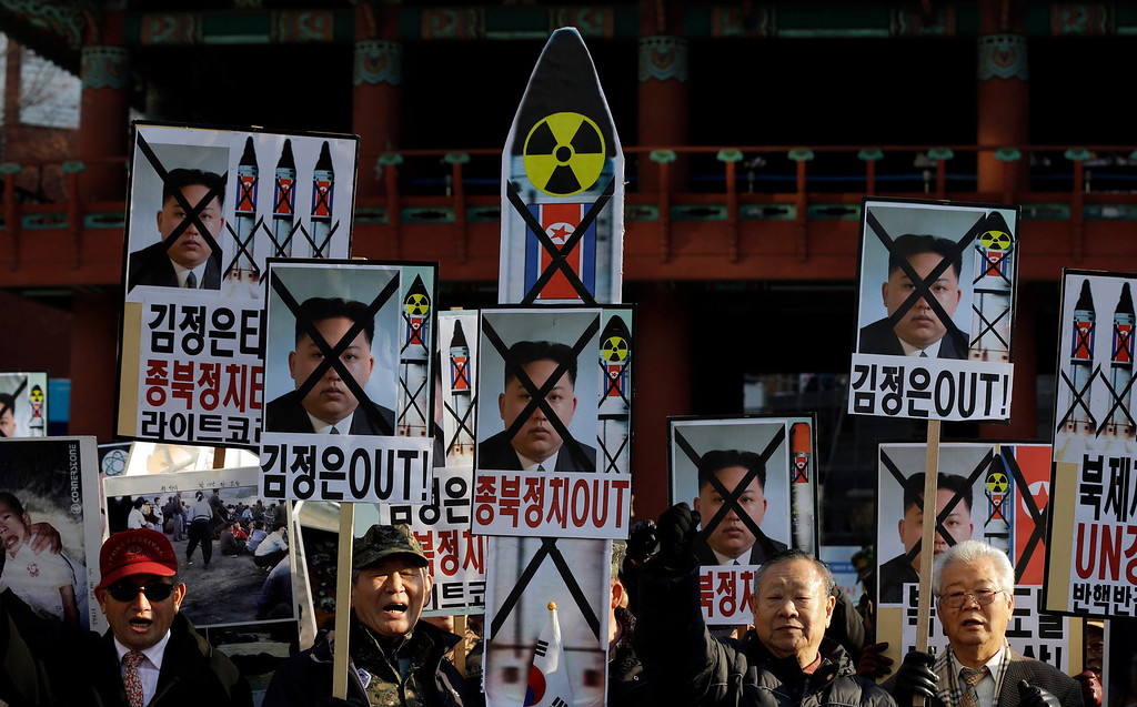 ". South Korean protesters shout slogans during a rally denouncing North Korea\'s rocket launch in Seoul, South Korea, Wednesday, Dec. 12, 2012. North Korea successfully fired a long-range rocket on Wednesday, defying international warnings as the regime of Kim Jong Un took a giant step forward in its quest to develop the technology to deliver a nuclear warhead. The letters on the sign read "" Out, Kim Jong Un.\"" (AP Photo/Lee Jin-man)"