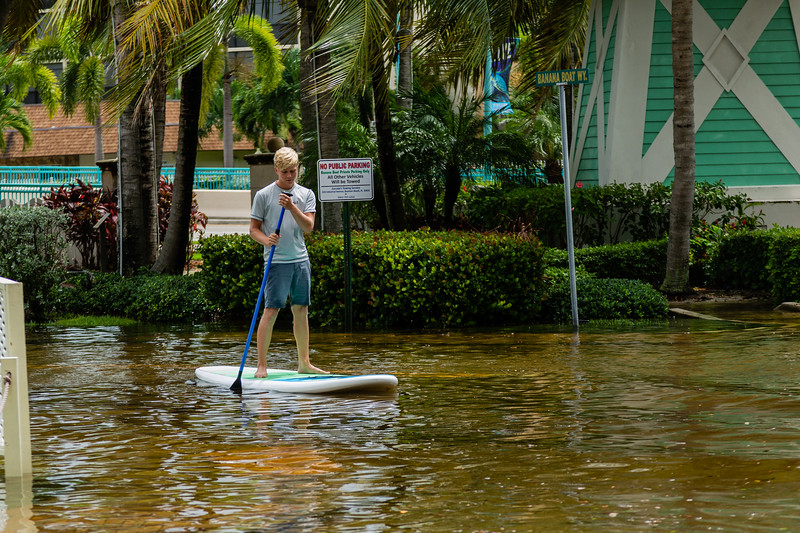 Zack Brand, 17, of Delray Beach, paddle boards in flood waters along NE 6th Street in Boynton Beach, on Tuesday, September 3, 2019. The flooding is a result of rains from Hurricane Dorian and the King Tide. [JOSEPH FORZANO/palmbeachpost.com]