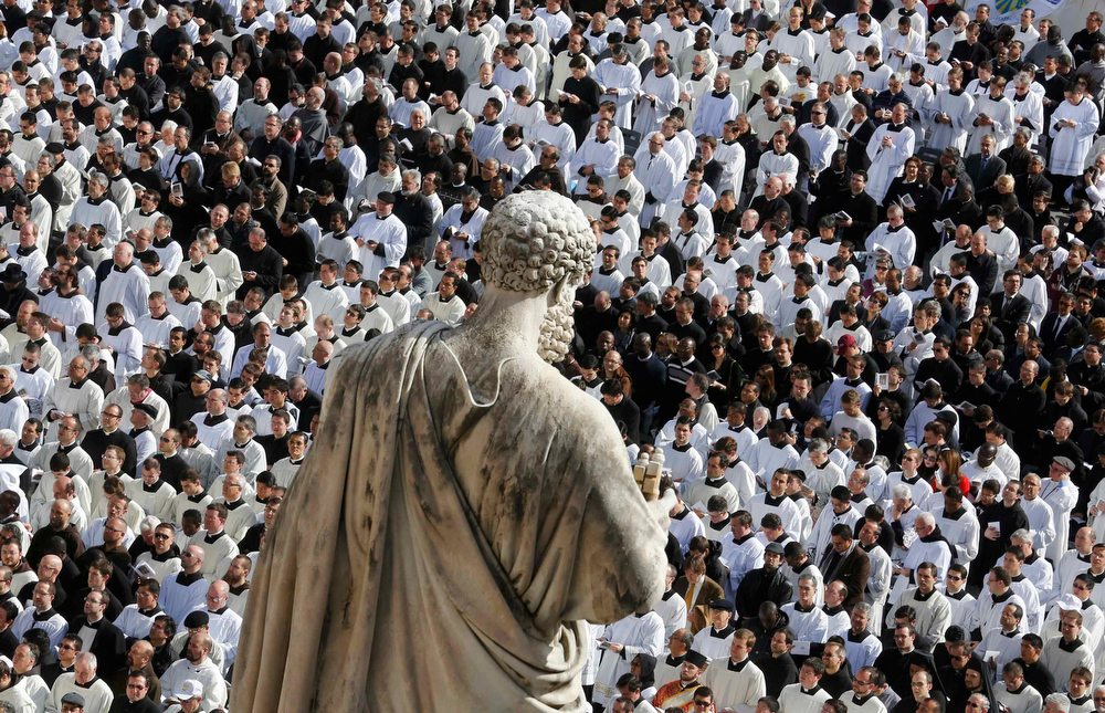 . Members of the clergy are seen near a statue of Saint Peter during the inaugural mass of Pope Francis in Saint Peter\'s Square at the Vatican, March 19, 2013. Pope Francis celebrates his inaugural mass on Tuesday among political and religious leaders from around the world and amid a wave of hope for a renewal of the scandal-plagued Roman Catholic Church.               REUTERS/Stefano Rellandini