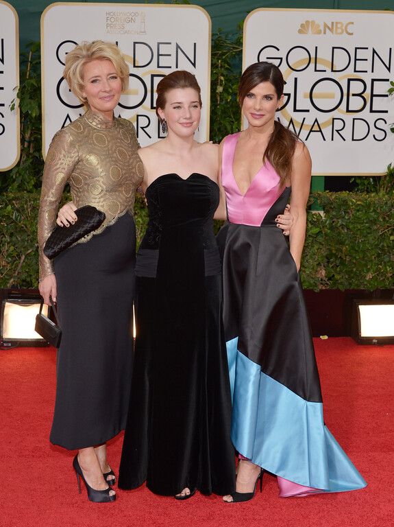 . From left, Emma Thompson, Gaia Romilly Wise and Sandra Bullock arrive at the 71st annual Golden Globe Awards at the Beverly Hilton Hotel on Sunday, Jan. 12, 2014, in Beverly Hills, Calif. (Photo by John Shearer/Invision/AP)