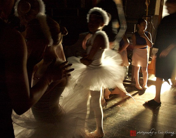 Young ballerina waits backstage to perform