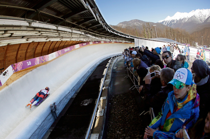 . Olga Potylitsina of Russia speeds down the track for her first run during the women\'s skeleton competition at the 2014 Winter Olympics, Thursday, Feb. 13, 2014, in Krasnaya Polyana, Russia. (AP  Photo/Charlie Riedel)