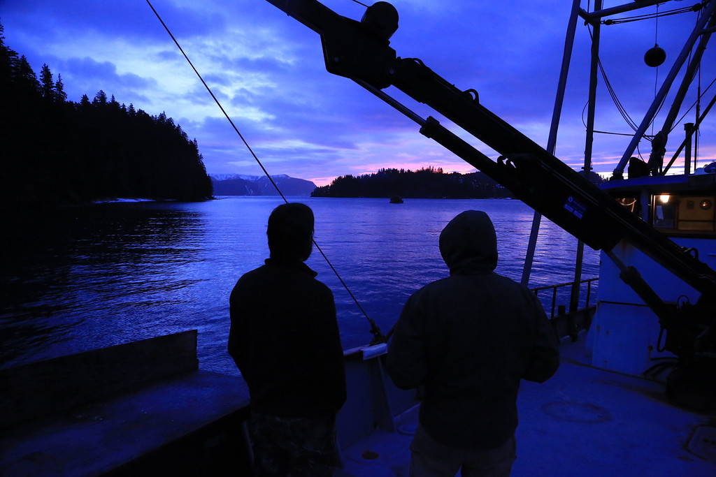 . Two people admire the bold colors of the sunset on a boat.  Provided by Discovery Channel