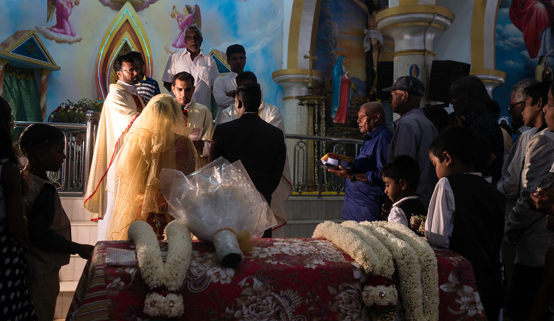 A christian wedding is being held at a small church of Colachel, Tamilnadu. Church plays an important role from fixing the arrange marriages to settling the dowry amount between the family of groom and bride. The people consult church for their day to day issues and counselling related to work and family.