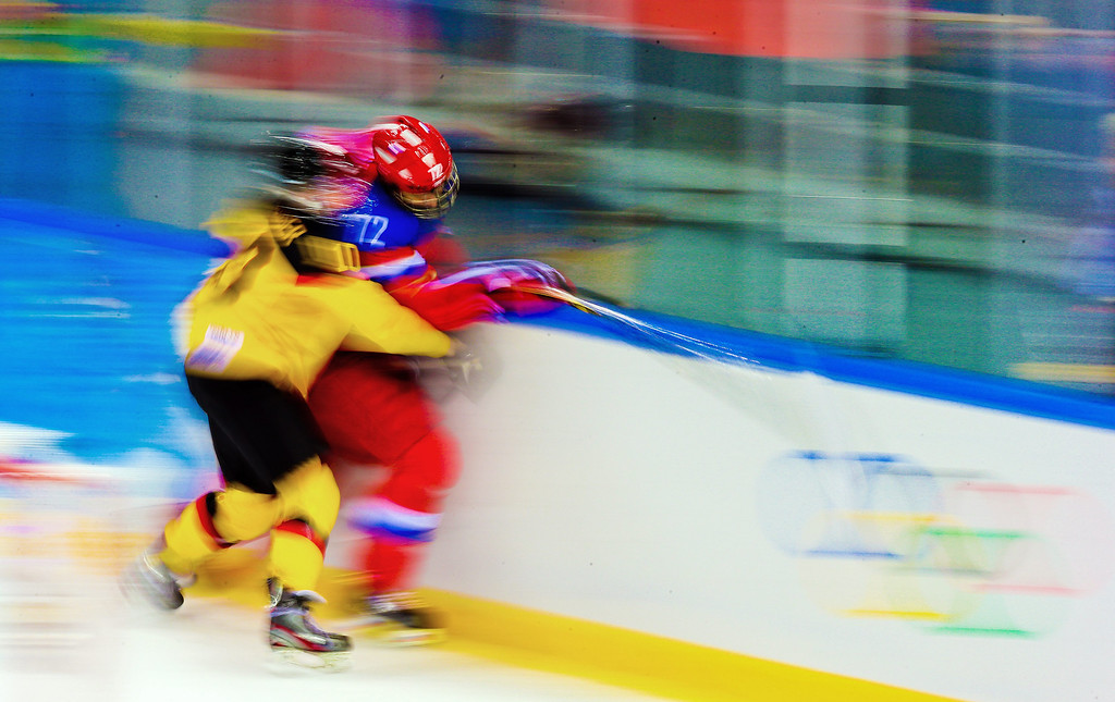 . Anja Weisser (L) of Germany fights for the puck with Yekaterina Pashkevich (R) during the match between Russia and Germany at the Shayba Arena in the Ice Hockey tournament at the Sochi 2014 Olympic Games, Sochi, Russia, 09 February 2014.  EPA/SRDJAN SUKI