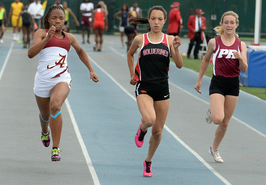 . Alemany\'s Asia Watts, left, with Harvard Westlake\'s Shea Copeland and Paso Robles Samantha Anderson competes in the division 3 100 meter dash during the CIF Southern Section track and final Championships at Cerritos College in Norwalk, Calif., Saturday, May 24, 2014.   (Keith Birmingham/Pasadena Star-News)