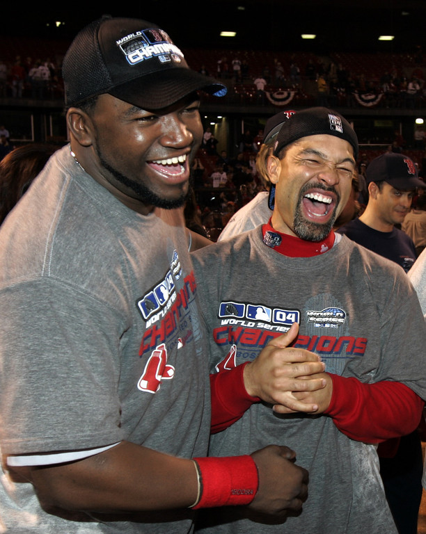 . Boston Red Sox\'s David Ortiz, left and teammate Dave Roberts celebrate after the Red Sox defeated the St. Louis Cardinals 3-0 in Game 4 to win the World Series at Busch Stadium in St. Louis, Wednesday, Oct. 27, 2004.  (AP Photo/Al Behrman)