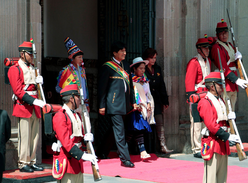 . Bolivia\'s President Evo Morales (C) accompanied by congressmen, is seen during celebrations of third year of the new Pluri-national state of Bolivia and Morales\' eighth continuous year of government, the second longest government in the history of Bolivia, in La Paz January 22, 2013. Morales, first indigenous president in the country\'s history, will celebrate on Tuesday, 2558 days in the Bolivian Presidency. Morales took office on January 22, 2006, after winning the presidential election with 53.7% and he was re-elected for a second term on 2010-2015 with 64% of the votes according local media. REUTERS/David Mercado