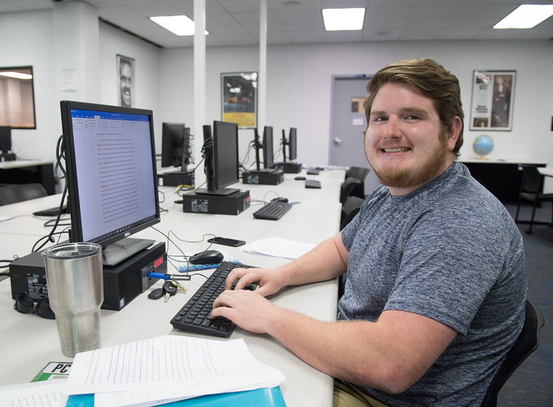 Malcolm Kunidk works on his history paper at the Mary and Jeff Bell Library's Media Center.
