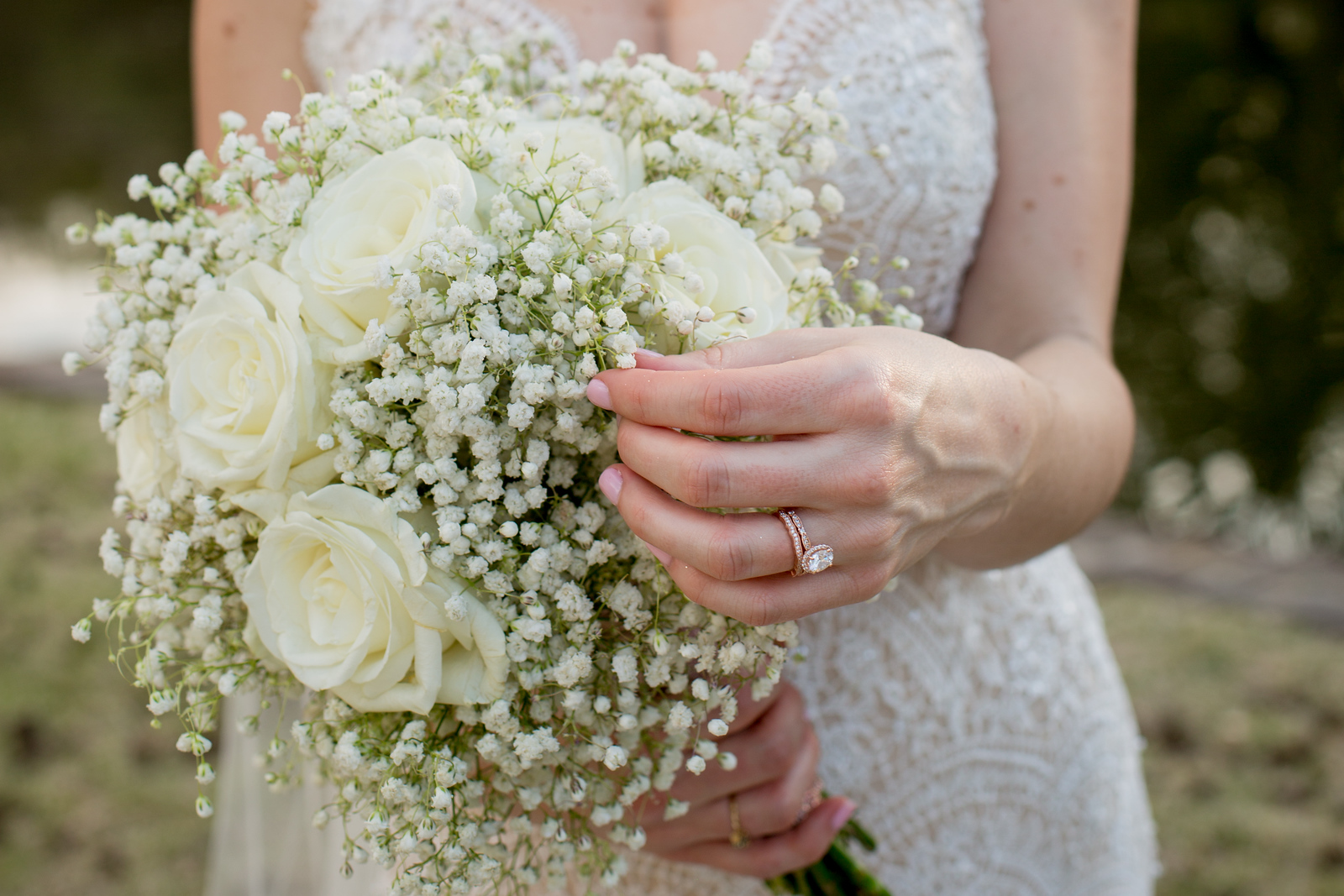 close up photo of a bride's engagement ring and bouquet