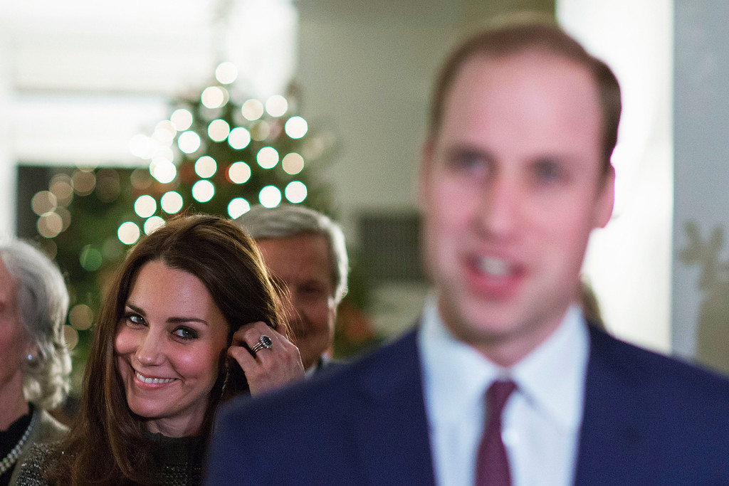 . Kate, the Duchess Of Cambridge, left, smiles while she listens to Britain\'s Prince William, the Duke of Cambridge, as he talks to guests during a reception co-hosted by the Royal Foundation and the Clinton Foundation at the British Consul General\'s residence, Monday, December 08, 2014 in New York. (AP Photo/  Eduardo Munoz Alvarez, Pool)