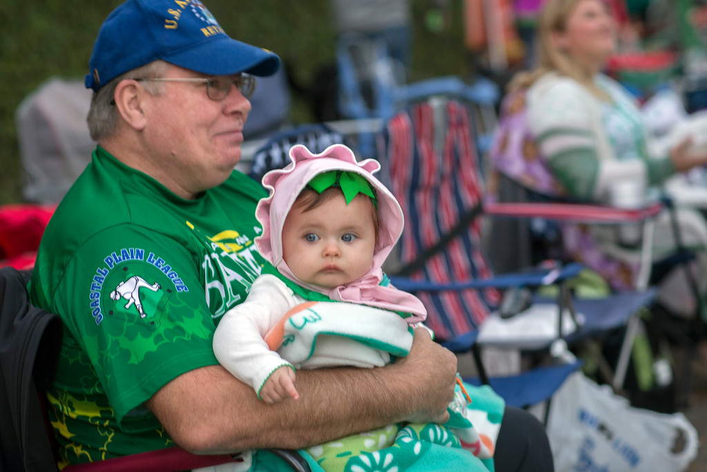 . Seven-month-old Lily Kangetter of Savannah sits with her grandfather Pat Sullivan before the start of the St. Patrick\'s Day parade, Saturday, March 17, 2018, in Savannah, Ga. Irish immigrants to Savannah and their descendants have been celebrating St. Patrick\'s Day with a parade since 1824. (AP Photo/Stephen B. Morton)