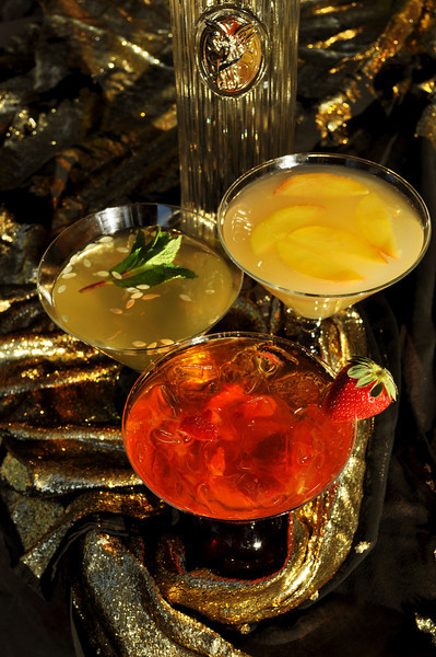 Photographs of 3 Summer Drinks by iS Vodka. Red drink is iS Ice Baby. Yellow is Perfect Peach iS Martini. Green is an iS Vodka Spa.