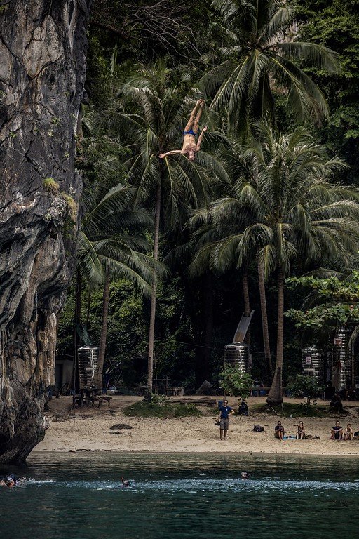 . In this handout image provided by Red Bull, Michal Navratil of the Czech Republic dives from the 27 meter platform at training on Hong Island in the Andaman Sea during the final stop of the 2013 Red Bull Cliff Diving World Series on October 25, 2013 at Krabi, Thailand. (Photo by Romina Amato/Red Bull via Getty Images)