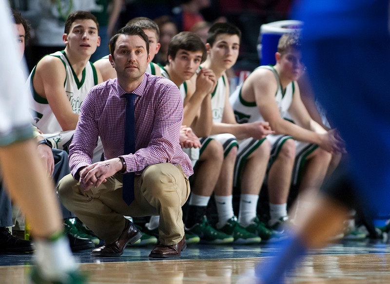 BANGOR, Maine -- 02/17/2017 -- Mount Desert Island' head coach Justin Norwood watches as his team takes on Belfast during their Class B boys basketball quarterfinal game at the Cross Insurance Center in Bangor Friday. Ashley L. Conti | BDN