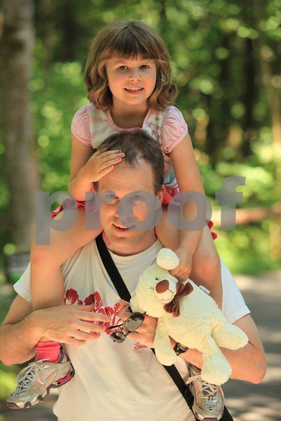After a long day at the zoo, where you can bring your own bear, nothing is better than riding home on dad's shoulders.