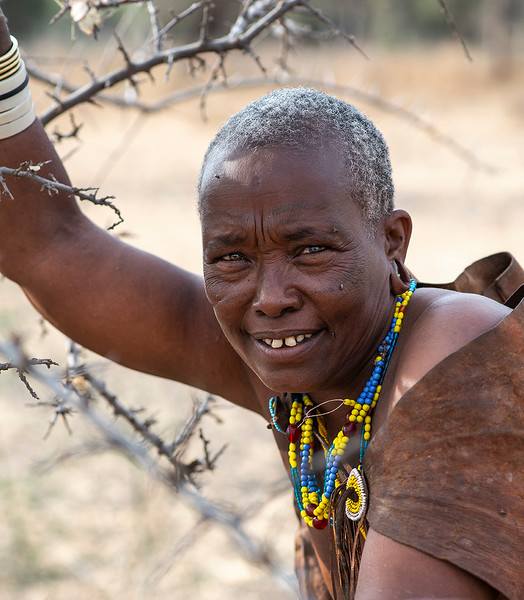 This lady from the Datoga tribe has Masai as neighbors. She explains how now they leave peacefully side by side but it has not always been this way. There was a time she recalls when the Masai killed the Datoga and stole their cattle. This caused the Datoga to escape and settle up in the hills.  Tanzania, 2019