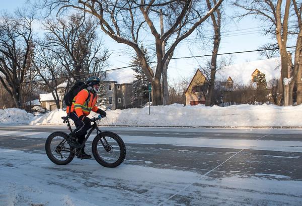 Jason Bekolay cycles to work Wednesday January 4, 2016. (David Lipnowski for Metro News)