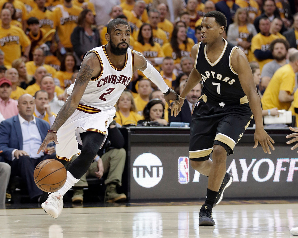 . Cleveland Cavaliers\' Kyrie Irving (2) drives past Toronto Raptors\' Kyle Lowry (7) during the first half in Game 2 of a second-round NBA basketball playoff series, Wednesday, May 3, 2017, in Cleveland. (AP Photo/Tony Dejak)