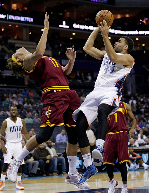 . Charlotte Bobcats\' Jeffery Taylor (44) shoots over Cleveland Cavaliers\' Anderson Varejao in the first half of a preseason NBA basketball game in Charlotte, N.C., Thursday, Oct. 24, 2013. (AP Photo/Chuck Burton)