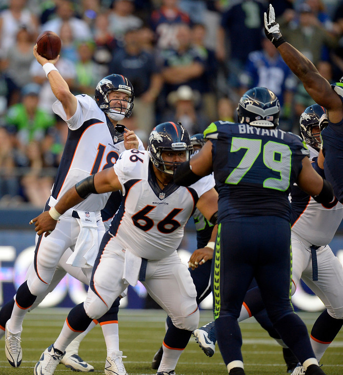 . SEATTLE, WA. - AUGUST 17: Denver Broncos quarterback Peyton Manning (18) throws over the Seattle Seahawks defense during the first quarter August 17, 2013 at Century Link Field. (Photo By John Leyba/The Denver Post)