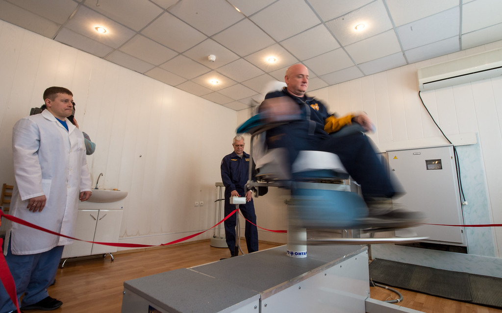 . In this Saturday, March 21, 2015 photo, Expedition 43 NASA Astronaut Scott Kelly goes through spin chair training during a media day in Baikonur, Kazakhstan. Kelly, and Russian Cosmonauts Gennady Padalka, and Mikhail Kornienko of the Russian Federal Space Agency (Roscosmos) headed to the International Space Station in a Soyuz TMA-16M spacecraft from the Baikonur Cosmodrome on March 28, 2015. As the one-year crew, Kelly and Kornienko are scheduled to return to Earth in March 2016. (Bill Ingalls/NASA via AP)