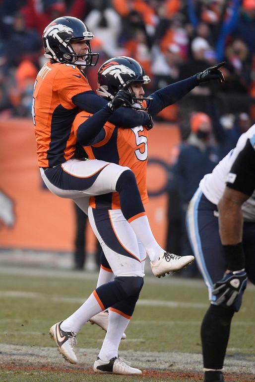 . Denver Broncos kicker Matt Prater (5) celebrates with Denver Broncos punter Britton Colquitt (4)  his record 64-yard field goal is good in the second quarter.  (Photo by John Leyba/The Denver Post)
