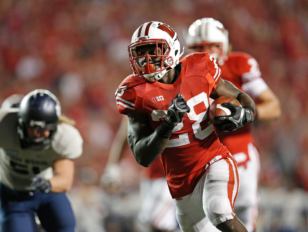 . MADISON, WI - SEPTEMBER 15: Running back Montee Ball #28 of the Wisconsin Badgers breaks through the Utah State Aggies defense for a touchdown in the third quarter September 15, 2012 at Camp Randall Stadium in Madison, Wisconsin.  (Photo by Tom Lynn/Getty Images)