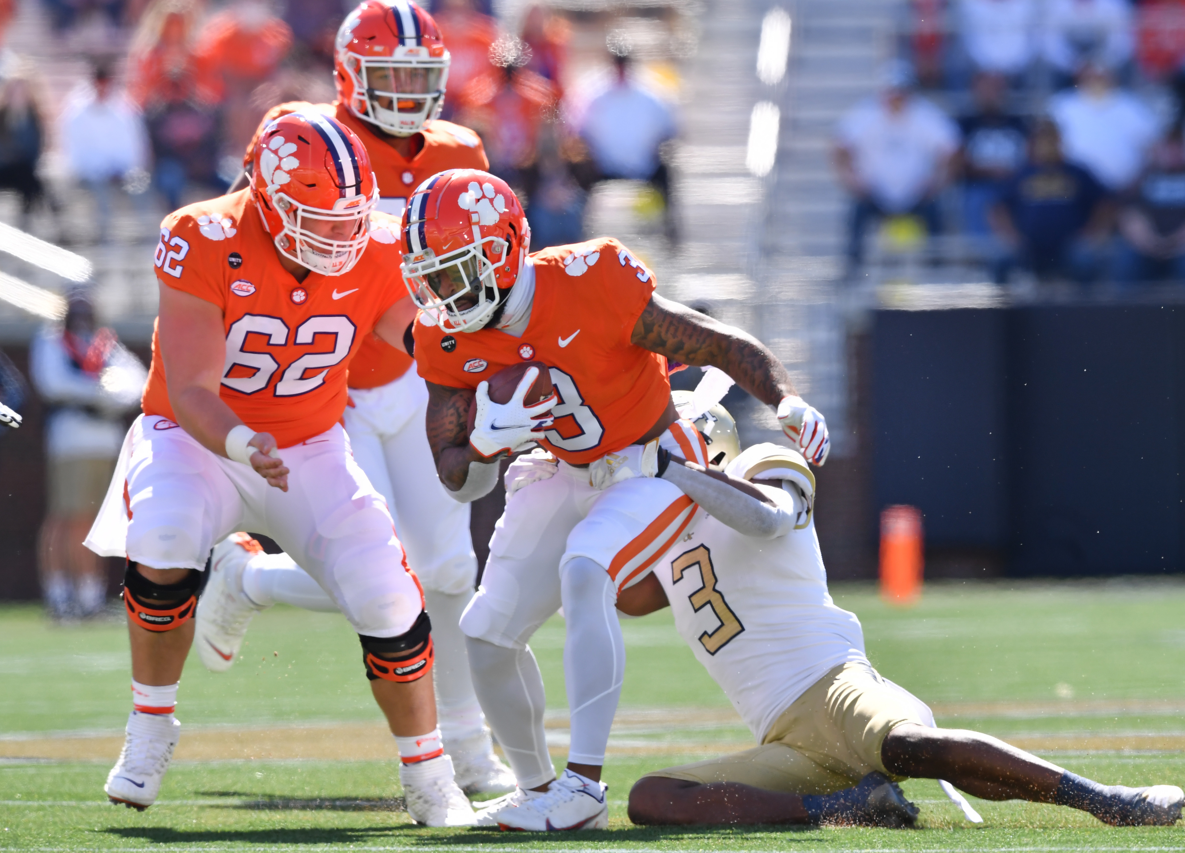 October 17, 2020 Atlanta - Clemson's wide receiver Amari Rodgers (3) gets tackled from behind by Georgia Tech's defensive back Tre Swilling (3) during the second half of an NCAA college football game at Georgia Tech's Bobby Dodd Stadium in Atlanta on Saturday, October 17, 2020. Clemson won 73-7 over the Georgia Tech. (Hyosub Shin / Hyosub.Shin@ajc.com)
