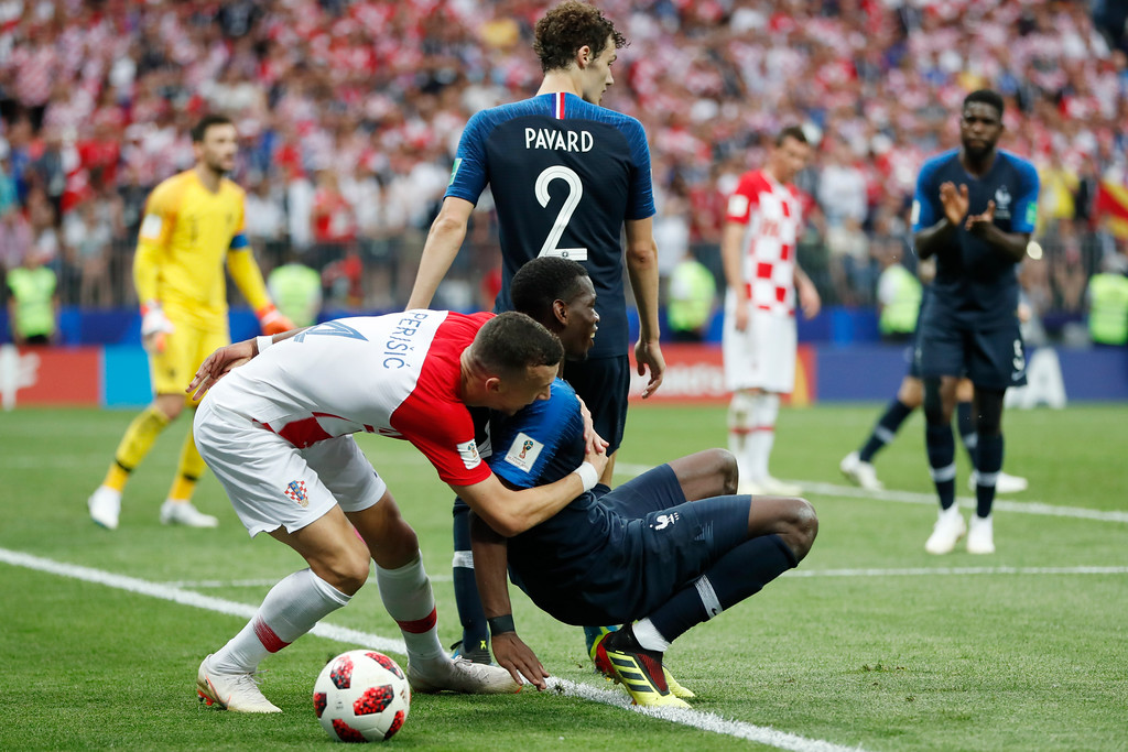 . Croatia\'s Ivan Perisic embraces France\'s Paul Pogba during the final match between France and Croatia at the 2018 soccer World Cup in the Luzhniki Stadium in Moscow, Russia, Sunday, July 15, 2018. (AP Photo/Natacha Pisarenko)