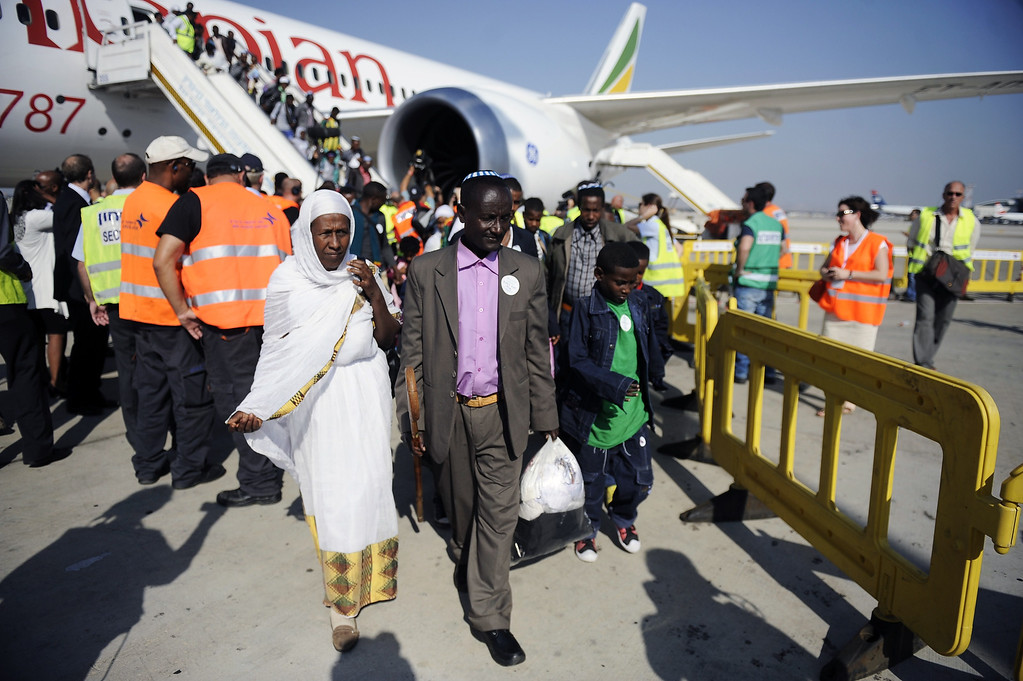 . Newly-arrived Jewish immigrants coming from Ethiopia step off the plane upon their arrival at Ben Gurion International Airport on August 28, 2013 near the Israeli costal city of Tel Aviv. DAVID BUIMOVITCH/AFP/Getty Images