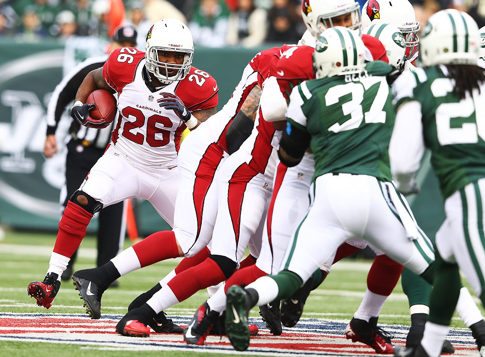 . Beanie Wells #26 of the Arizona Cardinals runs the ball against the New York Jets during their game at at MetLife Stadium on December 2, 2012 in East Rutherford, New Jersey.  (Photo by Al Bello/Getty Images)