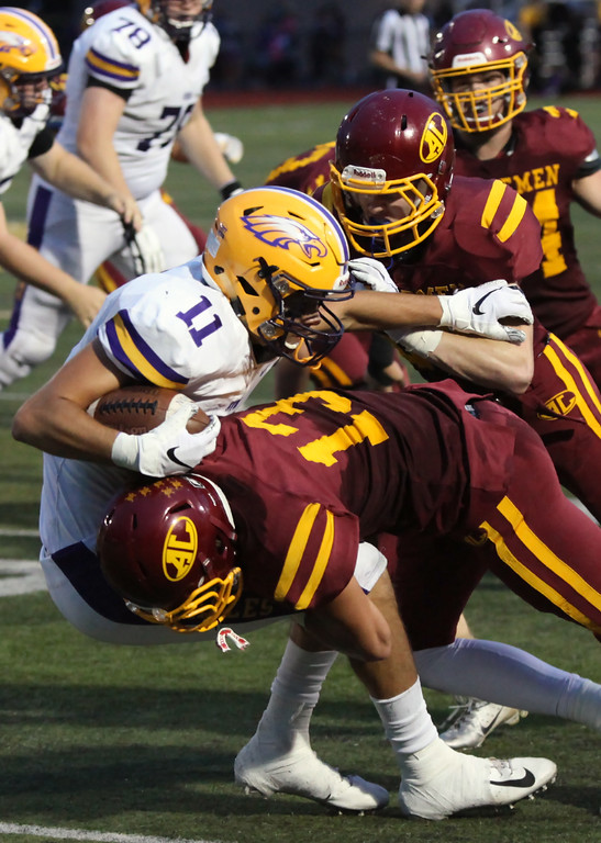 . Randy Meyers - The Morning Journal<br> Avon receiver Jake Parker is swarmed by the Avon Lake defense a short gain during the second quarter on Sept. 7.