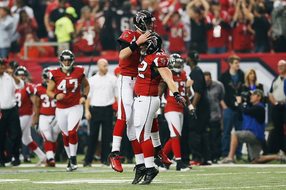 . Matt Ryan #2 celebrates a first quarter touchdown pass against the Seattle Seahawks with Mike Cox #42 of the Atlanta Falcons during the NFC Divisional Playoff Game at Georgia Dome on January 13, 2013 in Atlanta, Georgia.  (Photo by Kevin C. Cox/Getty Images)