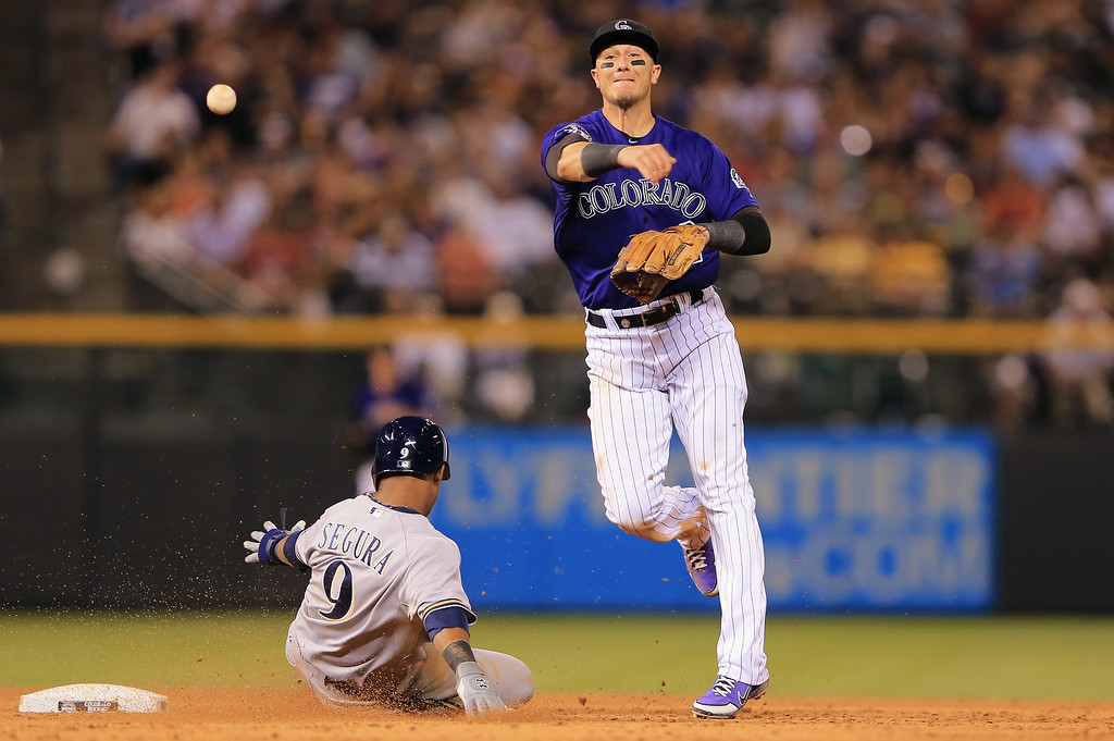 . DENVER, CO - JULY 26:  Shortstop Troy Tulowitzki #2 of the Colorado Rockies gets a force out on Jean Segura #9 of the Milwaukee Brewers in the sixth inning at Coors Field on July 26, 2013 in Denver, Colorado.  (Photo by Doug Pensinger/Getty Images)
