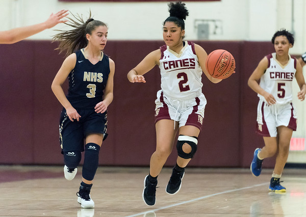 12/10/18 Wesley Bunnell | Staff New Britain girls basketball was defeated 52-39 at home against Newington on Thursday evening. Asia Gaines (2) guarded by karissa Zocco (3).