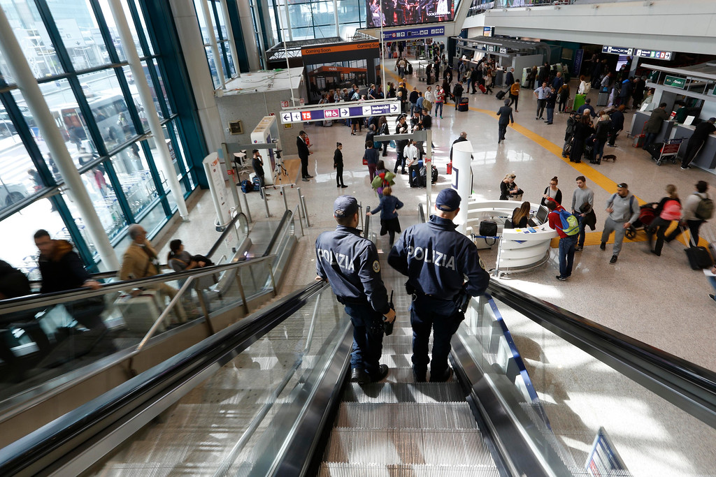 . Italian police officers patrol Leonardo Da Vinci airport in Fiumicino, near Rome, Tuesday, March 22, 2016. Authorities in Europe and beyond have tightened security at airports, on subways, at the borders and on city streets after deadly attacks Tuesday on the Brussels airport and its subway system. (AP Photo/Alessandra Tarantino)