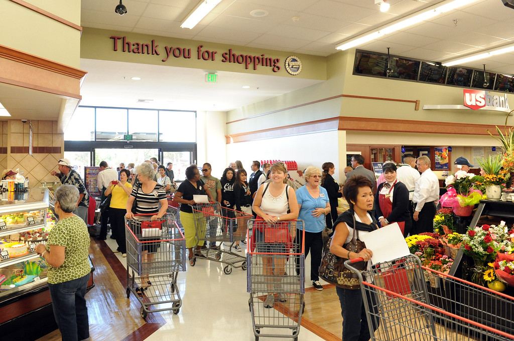 . (John Valenzuela/Staff Photographer) Customers enter the new Stater Bros. in Redlands during the grand opening of the grocery store, Wednesday, September 25, 2013. The new store replaces the one directly across the street, offering more amenities and services, including a bakery, seafood counter and wider aisles.
