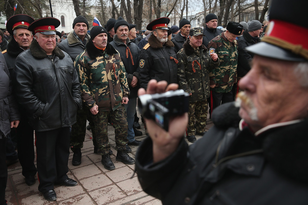 . Pro-Russian Cossacks rally outside the Crimean parliament building on February 28, 2014 in Simferopol, Ukraine. (Photo by Sean Gallup/Getty Images)