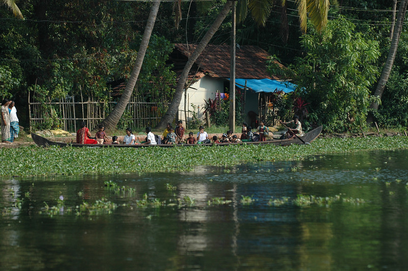 School children riding home from school along the backwaters of Kerala